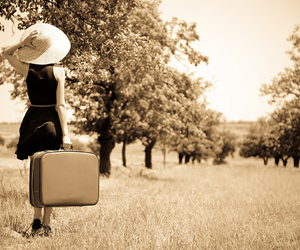 girl and suitcase image