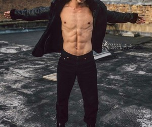 abs, curly hair, and male model image