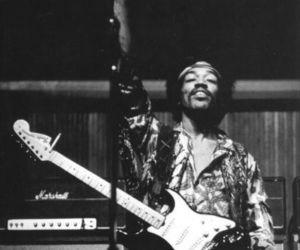 Jimi Hendrix, peace, and 60s image
