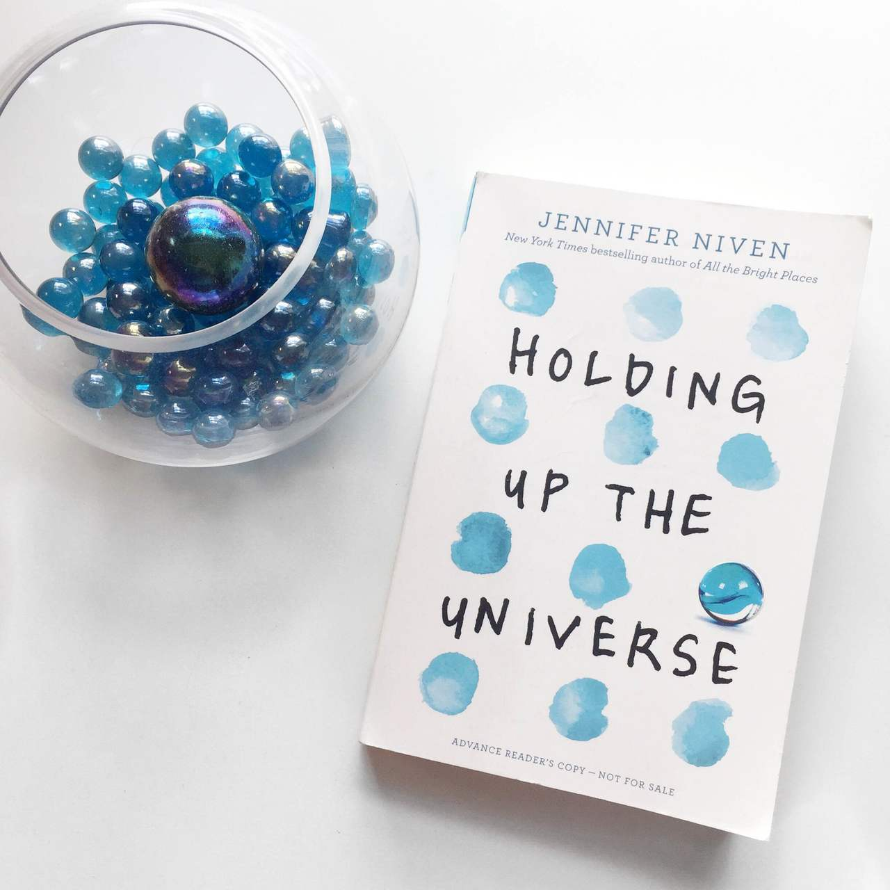 article, holding up the universe, and book image