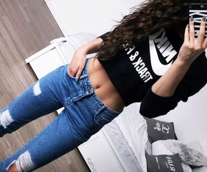 abdomen, curly hair, and jean image
