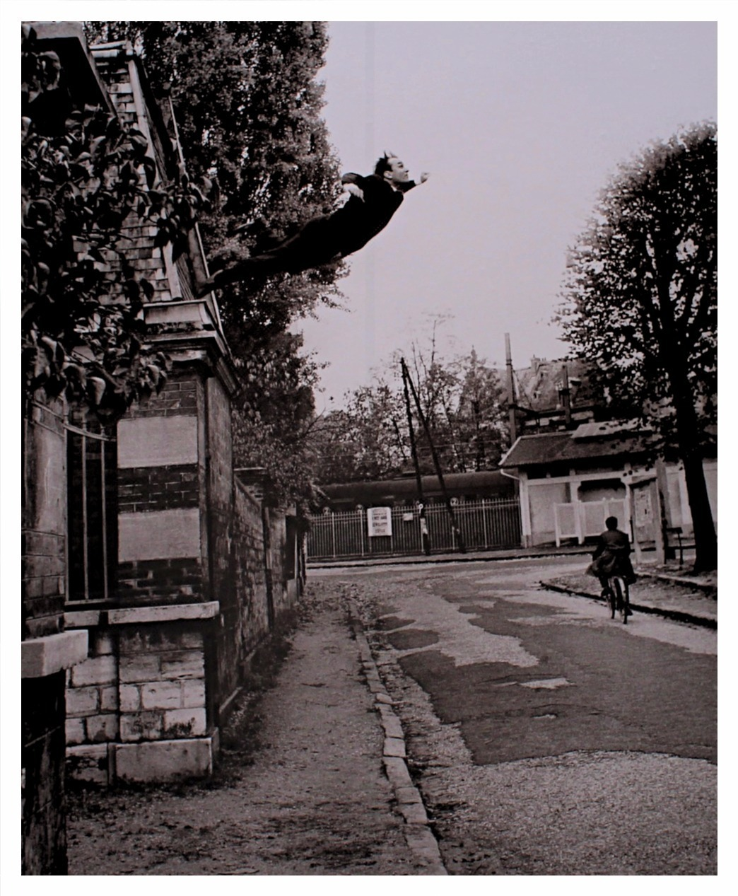 Yves Klein, black and white, and jump image