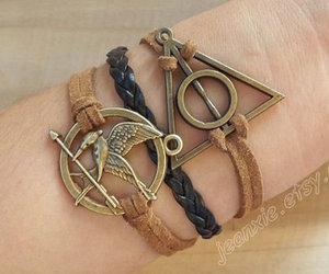 deathly hallows bracelet, catching fire, and leather bracelet image