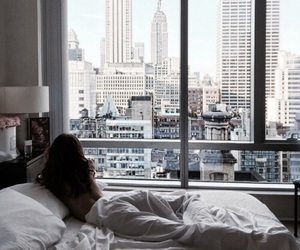 girl, city, and bed image