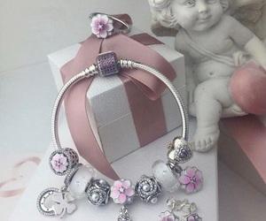 bracelets, earrings, and pandora image