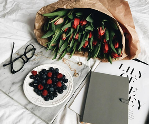 flowers, berries, and book image