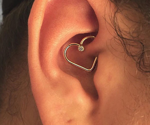 heart shape and tiny piercing image