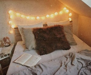 bed, book, and decorations image