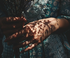 flowers, hands, and shadow image
