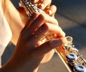 flute, hands, and instrument image