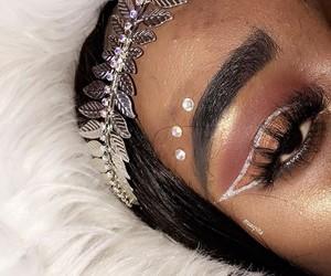 dress, eye makeup, and makeup artists image
