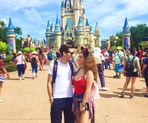 couple, disney castle, and disneyland image