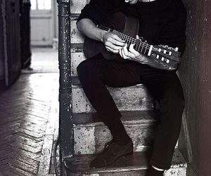 tom hiddleston, guitar, and black and white image