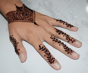 henna, henna tattoo, and red henna image