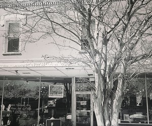 monochrome, shops, and small town image