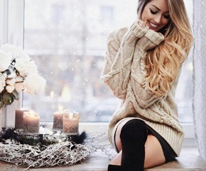 candles, flowers, and sweater image