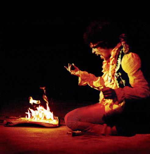 Jimi Hendrix, guitar, and fire image