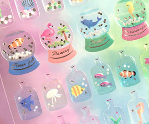 pressed flowers, snow globe, and stickers image