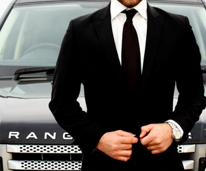 range rover, suit, and car image