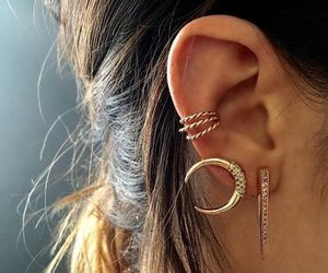 earrings, piercing, and gold image
