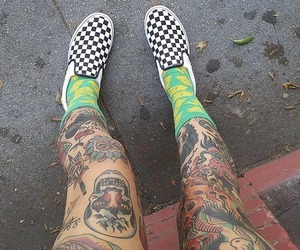 tattooed girl, thigh tattoo, and girls with tattoos image