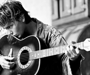 river phoenix and guitar image