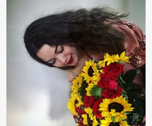brunette, roses, and sunflowers image