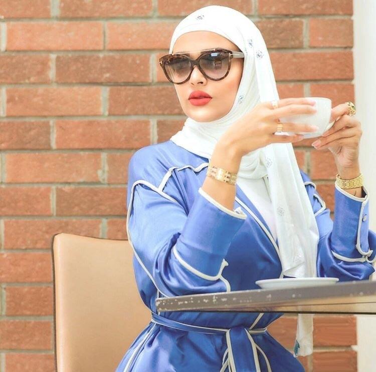 blue, white, and muslima image