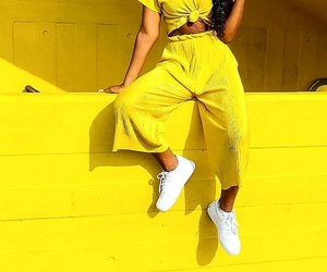 white sneakers, yellow pants, and long curly black hair image