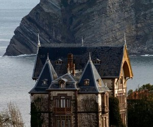 house, sea, and castle image