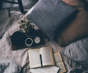 bed, books, and cozy image