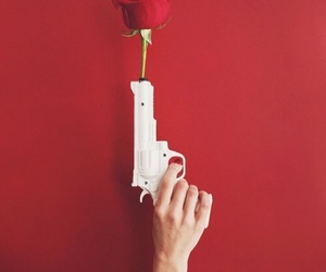 red, rose, and gun image