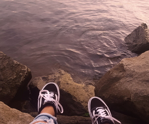 ripped jeans, vans, and water image