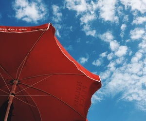blue, red, and clouds image