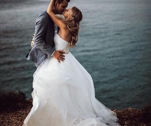 bride, groom, and hug image