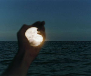 moon, hand, and sea image