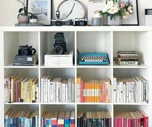 books, camera, and clock image