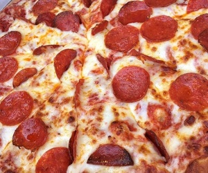 cheese, pepperoni, and cheesy image