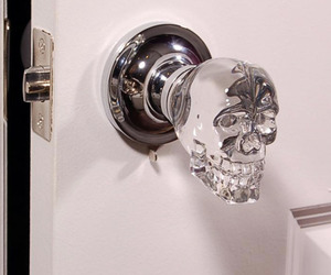 skull, door, and crystal image