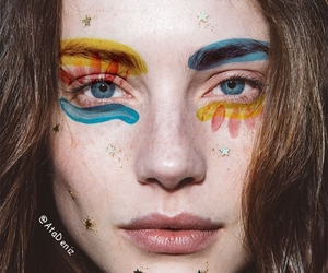 blue eyes, face paint, and festival makeup image