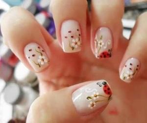 nails, flowers, and ladybug image