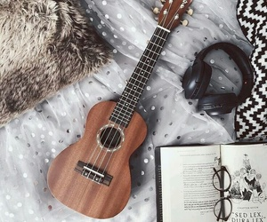 music, book, and guitar image