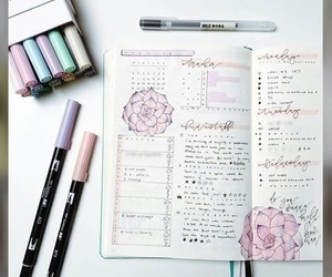 desk, notes, and planner image