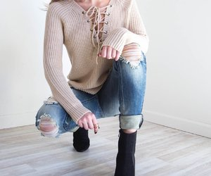 choker, ripped jeans, and sweater image