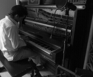 alex turner, arctic monkeys, and piano image