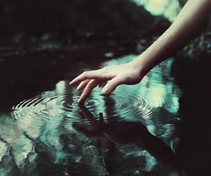 water, hand, and dark image