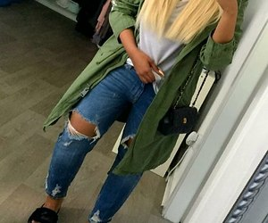 black purse, grey t-shirt, and blue ripped jeans image