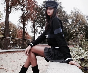 beret, black boots, and black skirt image