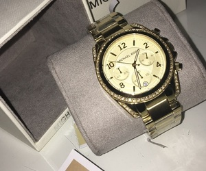 gold, watch, and kors image