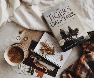 bedsheets, books, and brown image